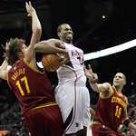 Atlanta Hawks center Jason Collins (34) loses the ball while defended by Cleveland Cavaliers forward Anderson Varejao (17) and guard Anthony Parker (18) during the second quarter of an NBA b …