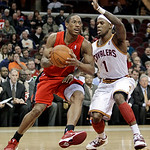 Toronto Raptors' DeMar DeRozan, left, drives past Cleveland Cavaliers' Daniel Gibson in the first quarter of an NBA basketball game Wednesday, Jan. 5, 2011, in Cleveland. (AP Photo/Tony Deja …