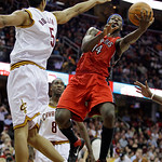 Toronto Raptors' Julian Wright (14) jumps toward the basket against Cleveland Cavaliers' Ryan Hollins (5) in the third quarter of an NBA basketball game Wednesday, Jan. 5, 2011, in Cleveland …