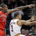 Cleveland Cavaliers' Ramon Sessions (3) tries to shoot around Toronto Raptors' Ed Davis (32) in the fourth quarter of an NBA basketball game Wednesday, Jan. 5, 2011, in Cleveland. The Raptor …