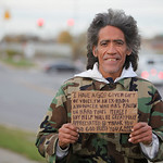 In this photo taken in late December, 2010, Ted Williams holds a sign advertising his smooth radio voice near a highway ramp in Columbus, Ohio. Williams, who is homeless, became an online vi …