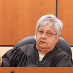 18NOV09  Visiting Judge Judith Cross asks the attorneys from both sides if they want the jurors individually poled on Ross's 19 convictions.  They did not.    photo by Chuck Humel
