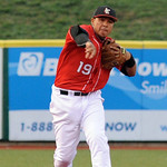 Crushers ss Wally Correa makes a put out throw to first base Aug. 16.  Steve Manheim