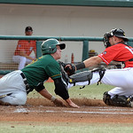 Crushers catcher Brian Erie tags out Cornbelters Patrick McKenna in first inn. Aug. 16.   Steve Manheim