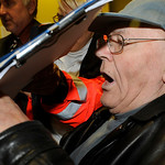 Police officers and medical assistants escort defendant John Demjanjuk, which sits in a wheelchair, during a trial break in Munich, southern Germany, Monday, Nov. 30, 2009. Demjanjuk is on t …