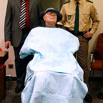 John Demjanjuk arrives at the court room for his trial in Munich, southern Germany, on Monday, Nov. 30, 2009. Demjanjuk goes on trial on charges of being an accessory to the murder of 27.900 …