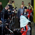 Police officers and medical assistants escort defendant John Demjanjuk, who lies on a stretcher, during a trial break in the court in Munich, Germany, Tuesday, Dec. 1, 2009. Demjanjuk goes …