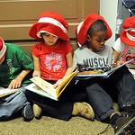 Asiyah Van Meter, left, Alyssa Green, Amarion Oliver and Grace Bradstock, all first graders,  read Dr. Suess books at McKinley Elementary for a Dr. Suess birthday celebration on Mar. 2, 2011 …