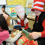 Lisa Ward, first grade teacher, reads with her students, Telyce Matthews, left, and Sophia Brown-White, at a Dr. Suess birthday celebration at McKinley Elementary March 2.  Steve Manheim