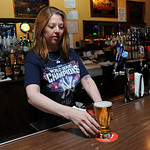 Jennifer Mitchell serves a beer at Pudge's Place on Broad St. May 12. Steve Manheim