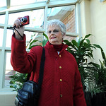Sue McKain, EHS Class of 1951, of Oberlin,  takes a picture in the greenhouse at the new Elyria High on Oct. 22.   Steve Manheim