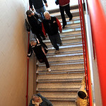 People walk down the staircase on a tour of the new Elyria High Oct. 22.   Steve Manheim