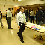 Jose Candelario, center, director of LC Board of Elections, inspects voting at Our Lady Queen of Peace Church in Grafton where two additional voting machines were added to move lines  quicke …