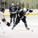 EC David Kukucka shoots past Rocky River's JR Schiau at WSC tournament Jan. 17. Steve Manheim