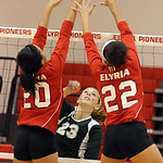 Medina 23 Jessie Sency hits over Elyria 20 Tyra Darden and 22 Alexis Middlebrooks at Elyria on Sep. 6.  Steve Manheim