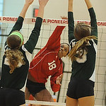 Elyria 18 Danya Corlew hits over Medina 23 Jessie Sency, left, and 3 Leah Svoboda on Sep. 6.   Steve Manheim