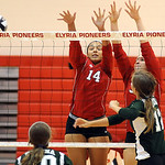 Medina Carmen DeRose, front right, hits past Elyria 14 Kayla Young and Emily Mandoke on Sep. 6.   Steve Manheim