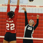 Medina 20 Kelly Kaletta hits over Elyria 22 Alexis Middlebrooks at Elyria on Sep. 6.  Steve Manheim