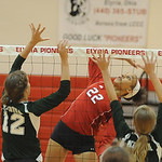Elyria 22 ALexis Middlebrooks hits past Medina 12 Carmen DeRose and Tess Fullerton, right, on Sep. 6.  Steve Manheim