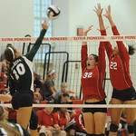 Elyria 32 Haley Looney and 22 Alexis Middlebrooks defend against Medina 10 Ksenia Klue at Elyria on Sep. 6.   Steve Manheim