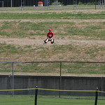 A fan watches from the hill as Elyria takes on Indiana.           photo by Chuck Humel