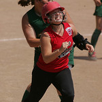 Mikayla Knapp flinches as she gets tagged out after laying a bunt down the first base line; however, her efforts advanced a runner to third.           photo by Chuck Humel
