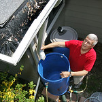 "Jerry Gubeno, who lives in Elyria, connects two  55 gallon rain barrels to his downspouts to save rainwater for later use on his plants. ""I save on my water and it saves the filtration plant …"