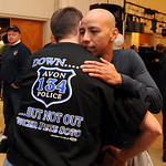 Avon Police Officer Pete Soto, right,  hugs Chris Barton, event organizer and K-9 officer for Avon Police Dept., at a Chili Cook Off benefit for Soto at Knights of Columbus Hall in Avon Feb. …
