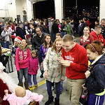 Parents and children wait their turns to visit with Santa in the LaGrange Firehouse during the LaGrange Christmas on the Square. photo by Ray Riedel