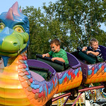 Tyler Sparks, 4, of Elyria, and Tyson Baranowski, 3, of Medina, ride the Dragon ride on Friday.  KRISTIN BAUER | CHRONICLE