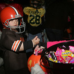 Tristan Baker, 3, of Amherst will probably have more success scoring candy than the Browns had scoring points as he trick or treats along Cleveland Street in Amherst.