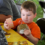 Bryce Ostrander, 3, of Toledo, debates which color of tape to use for his craft project at the Duck Tape Festival. KRISTIN BAUER | CHRONICLE
