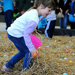 Danielle Dury, 6, of Elyria, hurries to collect Easter eggs at North Park on Saturday. KRISTIN BAUER/CHRONICLE