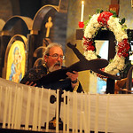 Father Michael Gulgas of St. Nicholas Greek Orthodox Church in Lorain removes Christ from the cross at a Good Friday ceremony. STEVE MANHEIM/CHRONICLE
