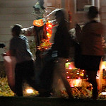 Karen Smith hands out candy in front of her Halloween display. Photo by Tom Mahl