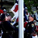 Members of the Elyria Police color guard present the flag at the Elyria High School marching concert.  KRISTIN BAUER | CHRONICLE