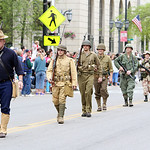 Members of the Elyria American Legion Post 12 march in United States military uniforms from different wars during the Elyria Memorial Day Parade yesterday morning. (CT photo by Anna Norris.)