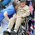 Rachel Fowler, left, gives her grandfather, Richard Vosburgh, a World War II veteran, a kiss before the start of the Elyria Memorial Day Parade yesterday morning. Vosburgh's great grandson,  …