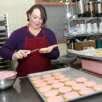 1oct09 bishop— COOKIES Dee dee Shullick of Lorain is a food prep worker for the Elyria City Schools ices just one tray of the nearly 50 dozen cookies the workesr produce at a time.