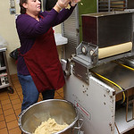 1oct09 bishop— COOKIES Dee dee Shullick of Lorain is a food prep worker for the Elyria City Schools. She is putting some of the cookie mixture in the industrial cookie cutter