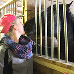 "Taylor Zehnder of Amherst kisses ""Star,"" an affectionate horse up for adoption, during the Angels Haven ""Hoppin Around the Barn"" fund raising event at Evergreen Farm in Grafton. photo by Ray …"