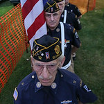 The Elyria American Legion Post 12 Color Guard waits in the wings to present the flag at the beginning of the main event. BRUCE BISHOP/CHRONICLE