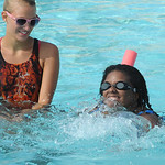 Lisa Roberson with instructor Jessica Peggs, a lifeguard at North Pool, on Aug. 2.  Steve Manheim