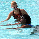 Lisa Roberson with instructor Jessica Peggs, a lifeguard at North Pool, at a swimming lesson on Aug. 2.  Steve Manheim