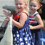 Kail Callihan, 2, front, and Payten Frye, 2, of Nova, clap at the 93rd annual Rochester homecoming parade on July 4.   Steve Manheim