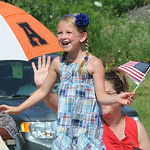 Brianna Reep, 6, of Wakeman, waves a flag at the 93rd annual Rochester homecoming parade on July 4.   Steve Manheim