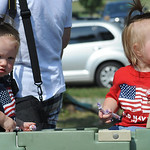 Sophia, left, an Olivia Klier, 16 months old, of Wellington, watch the 93rd annual Rochester homecoming parade on July 4.   Steve Manheim