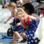Kail Callihan, 2, front, and Payten Frye, 2, of Nova, gather candy at the 93rd annual Rochester homecoming parade on July 4.   Steve Manheim