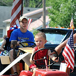 Conner Metro of New London drives a tractor in the 93rd annual Rochester homecoming parade July 4.  Steve Manheim