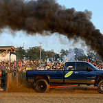 Heavy duty, modified pick-ups and tractors of all different makes, models and fuel-types competed in the annual Smoke Out Race by successfully demonstrating their ability to tow the Mighty M …